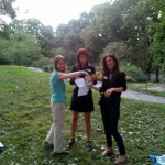 Kristi, Mackenzie, and Bridget hand out (out)door prizes.